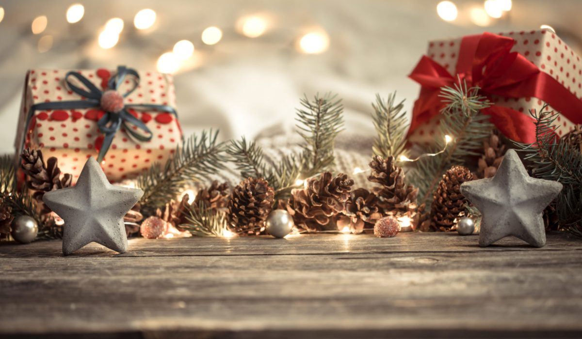 Composition with Christmas decorations in the interior. On a wooden background with lights . The concept of winter holidays and home comfort .